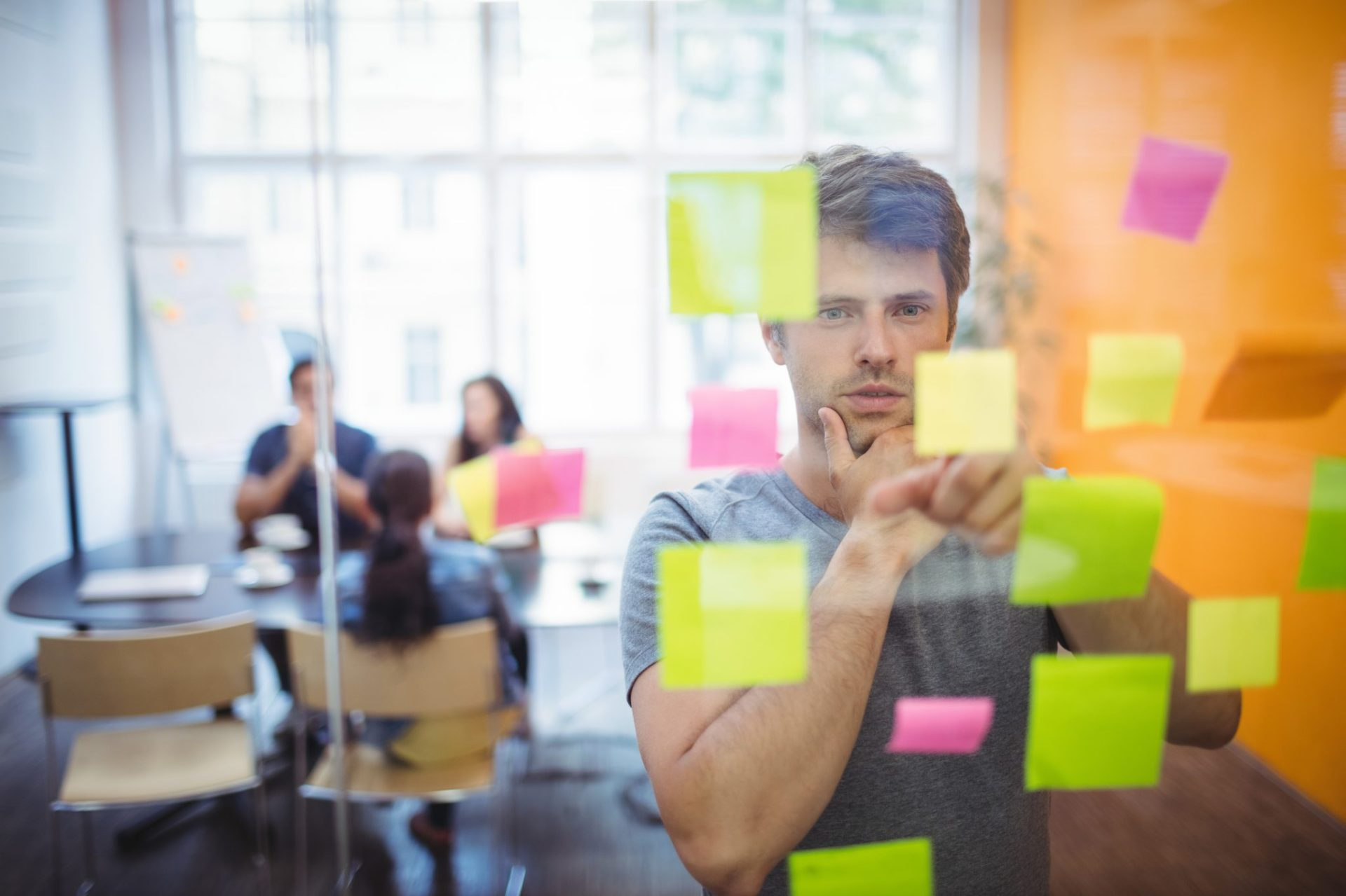 close-up-male-executive-reading-sticky-notes-scaled