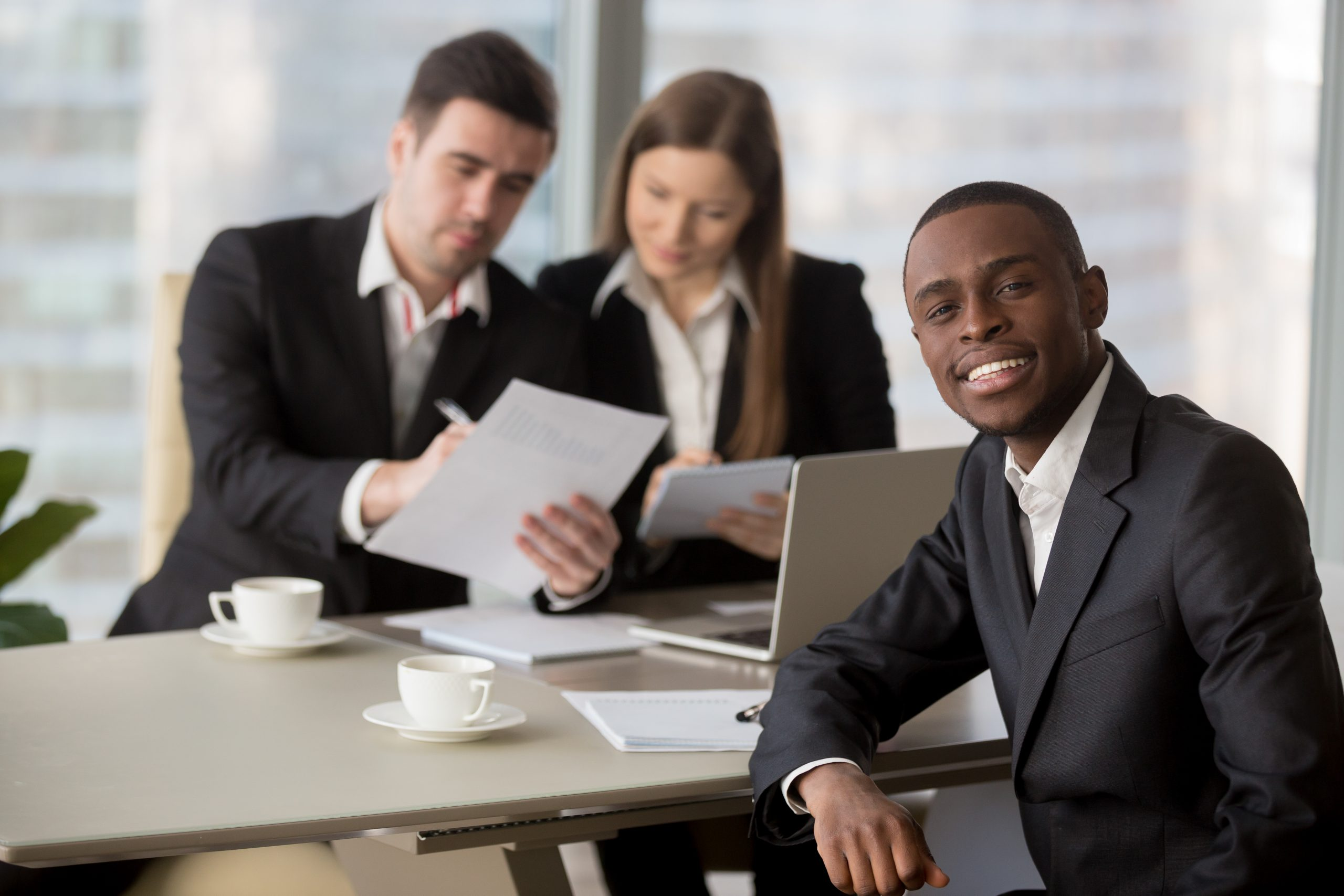HR managers reading resume of black job applicant